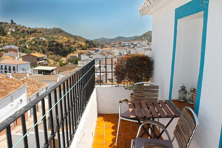 Cute andalusian white-washed village house