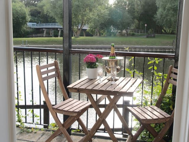 A riverside ground floor apartment with balcony